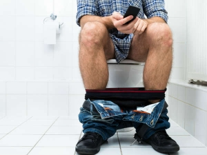 Why You Should Stop Using Your Phone In The Bathroom